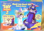 Click here to enlarge image and see more about item DC3: Toy Story 2 Rock'em Sock'em Robots Game Buzz & Zurg