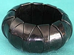 Click here to enlarge image and see more about item JCB68: Black Plastic Stretch Bracelet