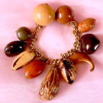 Click here to enlarge image and see more about item JVPL87: Vintage Seed & Nuts Charm Bracelet