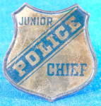 Click here to enlarge image and see more about item TOYGEN195: Vintage Child's Tin Police Chief Badge