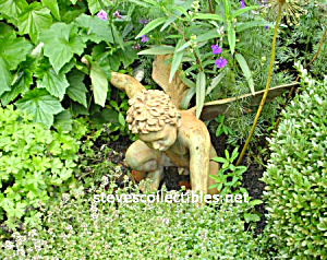 Winged Statuary In The Garden Photograph - Ltd Edition