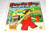 Click here to enlarge image and see more about item MCHBK1227F9: HIPPETY HOP AROUND THE BLOCK Tell-A-Tale Book