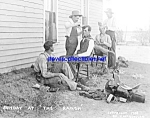 Click here to enlarge image and see more about item PR0317A1-2007: c.1908 COWBOYS Getting Haircuts ON RANCH Photo - 8 x 10
