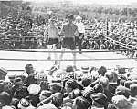 Click here to enlarge image and see more about item PR0527A1-2007: c.1919 OUTDOOR BOXERS IN RING-Referee-Audience - Photo