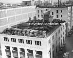 Click here to enlarge image and see more about item PR0527B1-2007: c.1925 BUICK DEALERSHIP - Roof Parking Photo - 8x10