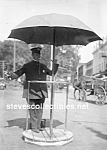Click here to enlarge image and see more about item PR0812A1-2007: c.1910 TRAFFIC COP (Policeman) Photo - 5x7