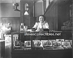Click here to enlarge image and see more about item PR0825A1-2007: c.1908 CIGAR STORE (Woman at Counter)  Photo - 8x10