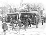 Click here to enlarge image and see more about item PR0831A3-713: c.1915 FIREMEN With STREETCAR PHOTO - matted - 5 x 7