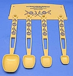 Click here to enlarge image and see more about item SEVENTY704A1: 1970s Advertising WALL HUNG MEASURING SPOONS Harv. Gold