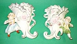 Click here to enlarge image and see more about item WP0721A1-2006: Pair of Vintage FIGURAL WALL POCKETS