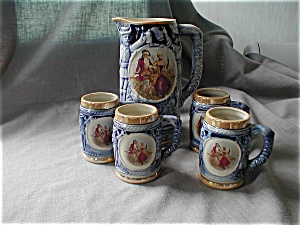 Stein Pitcher And Four Matching Mugs