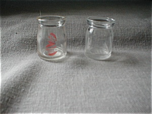A Pair Of Cream Bottles