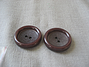 Two Brown Buttons