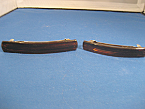 A Pair Of Brown Plastic Or Celliod Barrettes