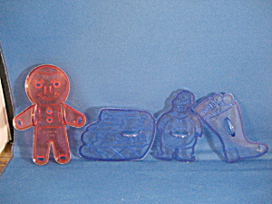 Four Plastic Christmas Cookie Cutters