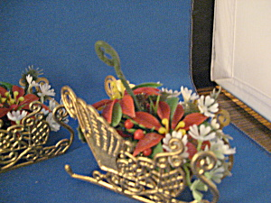 Three Plastic Sleigh Ornaments