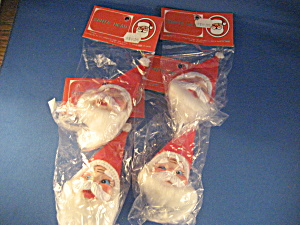 Four Plastic Santa Heads