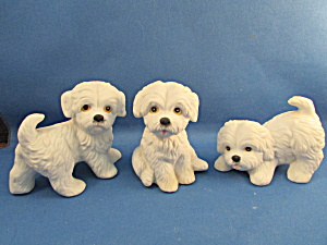 Three Homco Dog Figurines