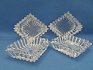 Four Heavy Glass Ash Trays