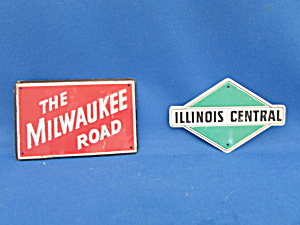 Two Metal Toy Train Signs