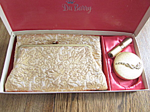Dubarry Folded Gold Purse, Gold Compact, And Lipstick