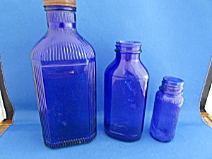 Three Blue Glass Bottles
