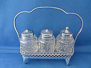Salt, Pepper, And Sugar Castor With Silver Tray
