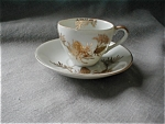 Click here to enlarge image and see more about item 1473: Miniature Sterling Cup and Saucer