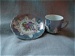 Click here to enlarge image and see more about item 1569: Blue Minature Cup and Saucer