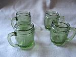 Four Miniature Green Barrel Shot Glass