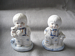 Two Boy Figurines
