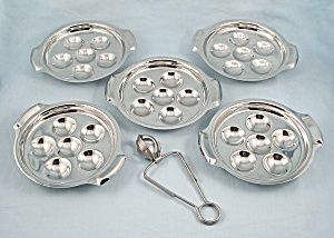 Five – Inox,  Escargot Trays / Plates & One Tong	 (Image1)