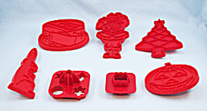 Seven Red Tupperware Cookie Cutters
