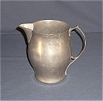 Click here to enlarge image and see more about item TE0170: Benedict Pewter Pitcher