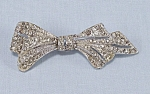 Click here to enlarge image and see more about item TE0589: Rhinestone Bow Pin