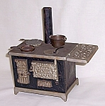 Click here to enlarge image and see more about item TE0704: Venus Cast Iron and Tin Toy Stove with Accessories