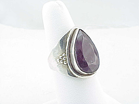 UNIQUE PURPLE SAPPHIRE SET IN HAND MADE STERLING SILVER RING (Image1)