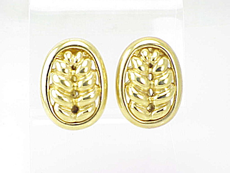 COSTUME JEWELRY - LARGE GOLD TONE SWIRL OR LEAF DESIGN CLIP EARRINGS SIGNED GIVENCHY (Image1)