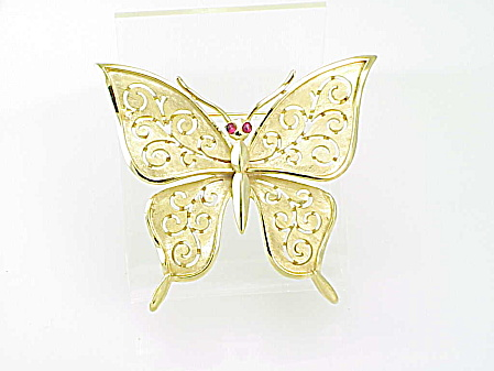 COSTUME JEWELRY - VINTAGE BUTTERFLY BROOCH WITH RED GLASS EYES SIGNED TRIFARI (Image1)
