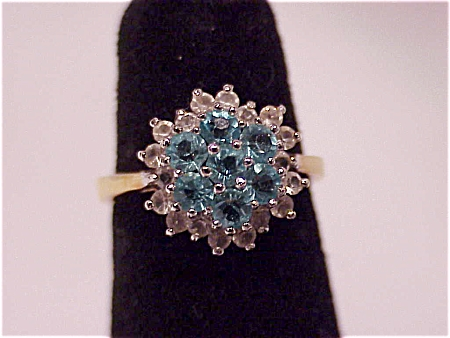 COSTUME JEWELRY - 14K GOLD ELECTROPLATE RING WITH TOPAZ BLUE RHINESTONES (Image1)