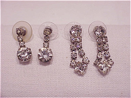 TWO PAIRS OF DANGLING CLEAR RHINESTONE PIERCED EARRINGS (Image1)