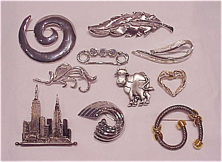 COSTUME JEWELRY - LOT OF 10 SILVER TONE BROOCHES - 1 SARAH COVENTRY, 1 JJ (Image1)