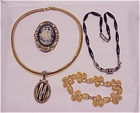 COSTUME JEWELRY - 4 PIECES OF MIXED COSTUME JEWELRY - CAMEO, NAPIER BRACELET, 2 NECKLACES - 1 LIZ CLAIBORNE (Image1)