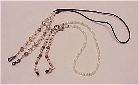 2 EYEGLASSES HOLDER NECKLACES - 1 WITH CRYSTALS AND 1 WITH PEARLS (Image1)