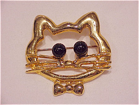 COSTUME JEWELRY - GOLD TONE CAT OR KITTEN FACE BROOCH WITH BLACK BALL EYES (Image1)
