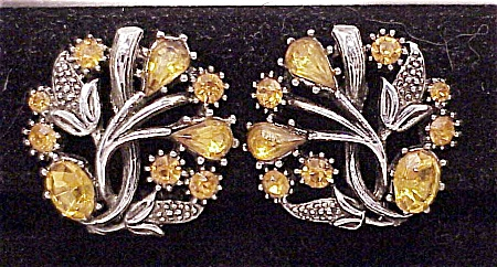 COSTUME JEWELRY - VINTAGE AMBER RHINESTONE CLIP EARRINGS SIGNED STAR (Image1)