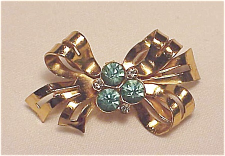 Vintage Coro Gold Tone Bow Brooch With Blue Rhinestones