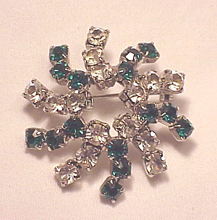 VINTAGE COSTUME JEWELRY - GREEN AND CLEAR RHINESTONE SWIRL BROOCH (Image1)