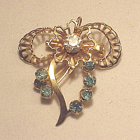 VINTAGE COSTUME JEWELRY - BLUE RHINESTONE GOLD TONE BOW BROOCH OR PENDANT (Image1)
