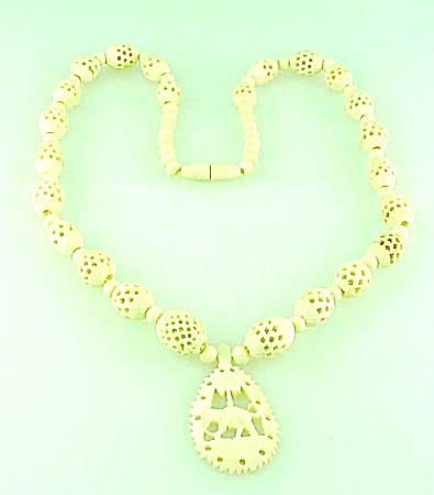VINTAGE COSTUME JEWELRY - VINTAGE CARVED FAUX IVORY OR BONE NECKLACE WITH ELEPHANT PENDANT (Image1)